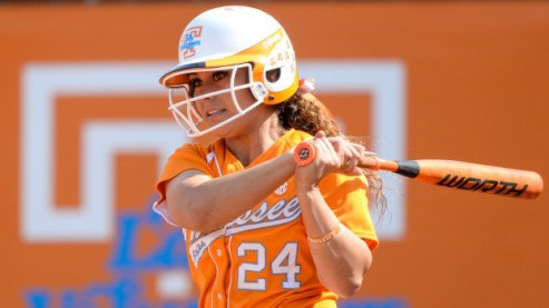 KNOXVILLE, TN - MARCH 22, 2014: Catcher/Infielder Annie Aldrete #24 of the Tennessee Lady Volunteers during the conference match between the University of Tennessee Lady Volunteers and the South Carolina Gamecockss at Sherri Parker Lee Stadium in Knoxville, TN.  Photo By Andrew Bruckse/Tennessee Athletics